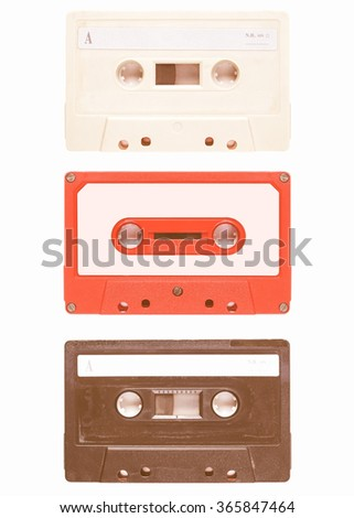 Magnetic tape cassette for audio music recording - isolated over white background vintage - stock photo