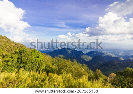 Majestic mountains landscape under morning sky with clouds. - stock photo