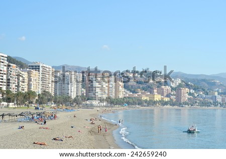 MALAGA,SPAIN - SEPTEMBER 25, 2014: Crowded beach with tourists in summer on September 25, 2014 in Malaga,Spain. Malaga  is a famous summer destination for hundred of thousands of tourists a year.