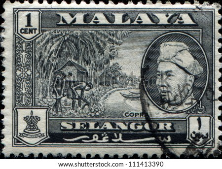 MALAYA - CIRCA 1957: A stamp from state Selangor of the Federation of Malaya shows making copra and portrait of Sultan Hisamud-din Alam Shah, circa 1957 - stock photo