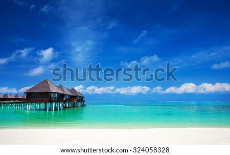 Maldives sea with few palm trees and blue lagoon