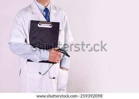 male doctor holding clipboard and stethoscope prescription,Medicine concept (with copy space) - stock photo