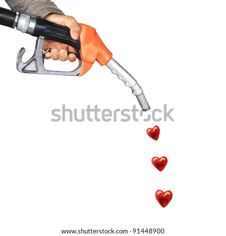 Male hand holding gas pump  and red heart drop - stock photo