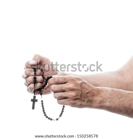 male hands praying with rosary - colorized photo with white background - stock photo