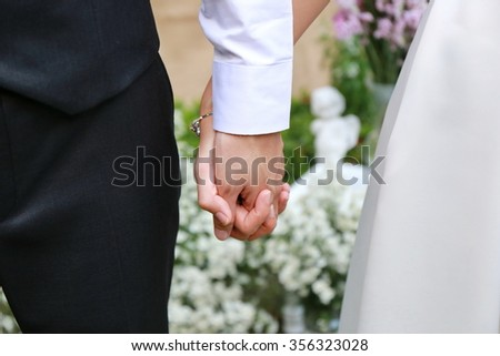 man and women hold hand together, lover - stock photo
