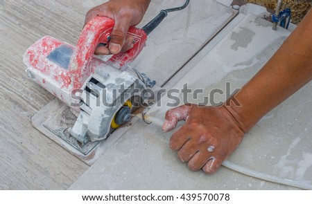 Man cutting a ceramic floor tiles