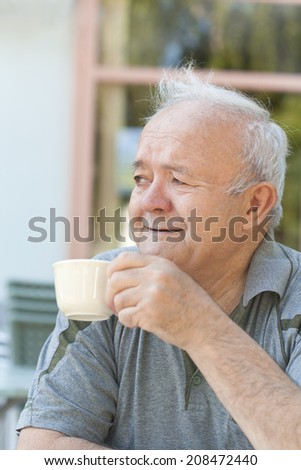 man enjoying coffee - stock photo