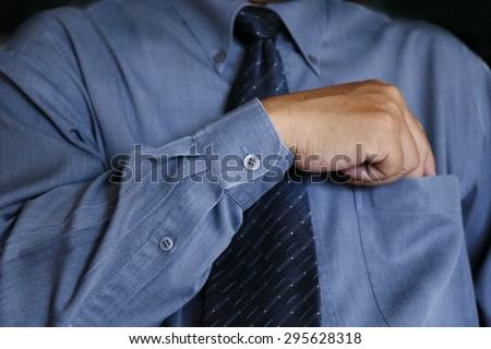 man hand pick something in shirt pocket - stock photo