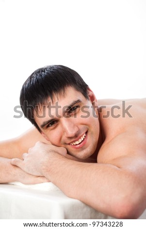 man lying on the couch on white background - stock photo