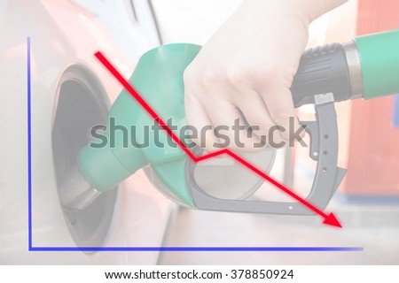 man pumping gasoline fuel in car at gas station a down chart in concept - stock photo
