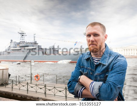 man sailor at  waterfront in St. Petersburg during the parade of the Navy