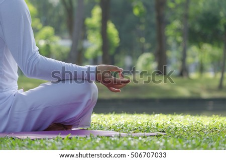Man sits in Park for meditation.