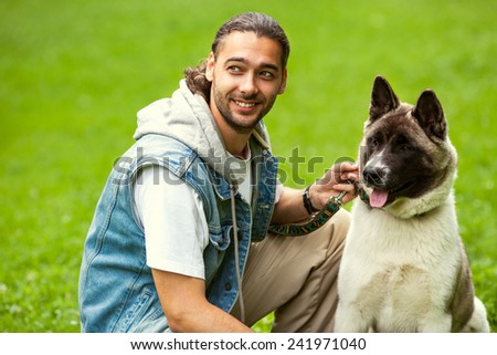 man with his dog breed Aki - stock photo