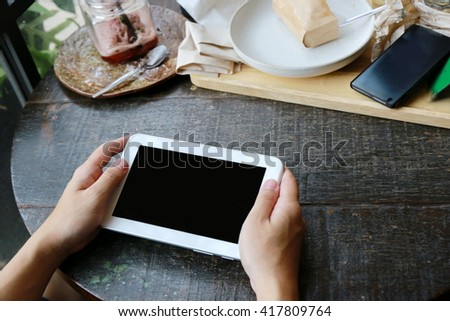man working on a digital tablet - stock photo