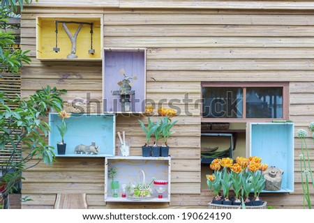 Manicured House and Garden displaying perennial gardens  - stock photo