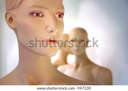 3 mannequin dummies, facing other directions. Soft focus.