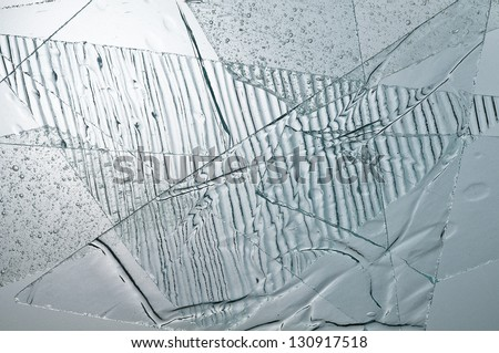 Many piese of transparent glasses with different textures. - stock photo