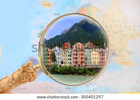 Map of Europe with magnifying glass looking in on Innsbruck, Austria, Europe