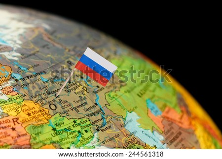 Map with miniature Flag of Russia. Selective focus on Russian Flag in Moscow  - stock photo