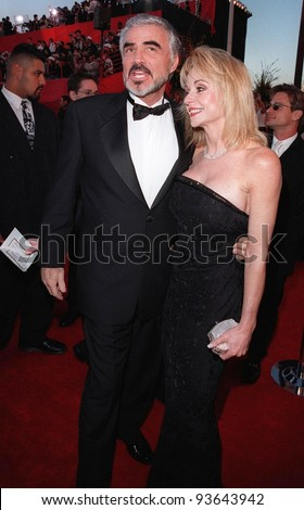 23MAR98:  Actor BURT REYNOLDS & girlfriend PAM SEALS at the 70th Academy Awards.