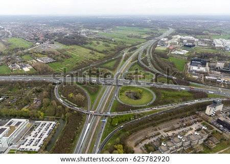 30 March 2017, Utrecht, Holland. Aerial view of cloverleaf junction Rijnsweerd on highway A27  freeway A28 in the early spring.