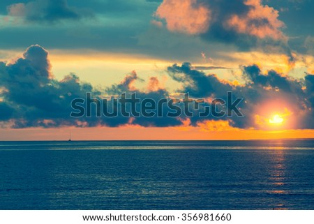 Marine landscape with cloudy sky. Sunset over sea - stock photo