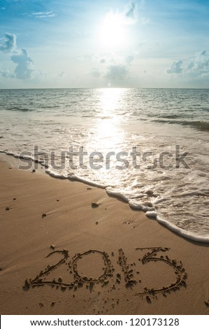 2013 marked the sand at the beach - stock photo
