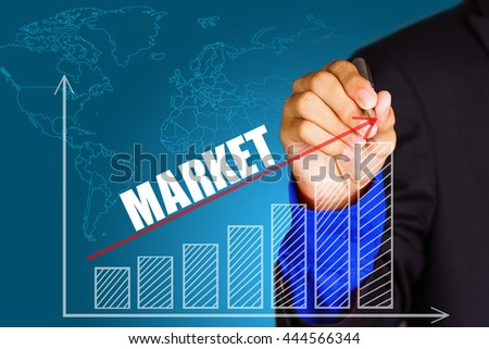 """""""Market"""" text with hand of young businessman point on virtual graph red line and bar showing on increasing with background -business, finance, salary, crisis, and development concept - stock photo"""