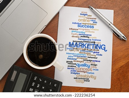 """""""MARKETING word cloud arrangement"""" Notebook with text vision on table with coffee, calculator and notebook - stock photo"""