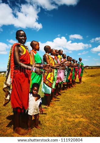 MASAI MARA,KENYA-NOVEMBER 12: Masai women sings traditional song as cultural ceremony, review of daily life of local people, near Masai Mara National Park Reserve, November 12, 2008, Kenya - stock photo