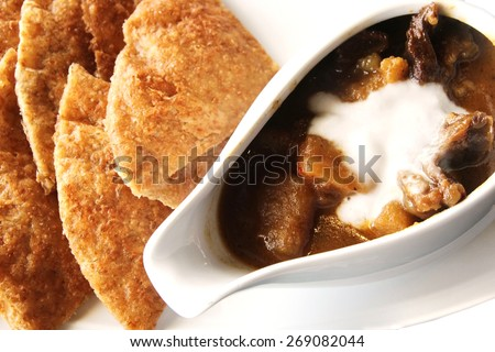 Massaman beef curry with bread sheet, Thai food  - stock photo