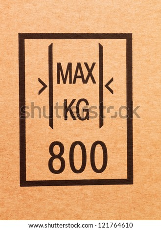 """Maximum load"" sign on a cardboard box - stock photo"