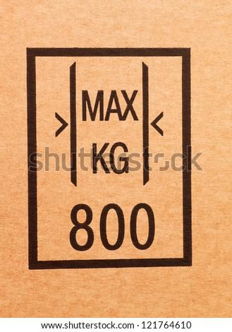 """Maximum load"" sign on a cardboard box - stock photo"