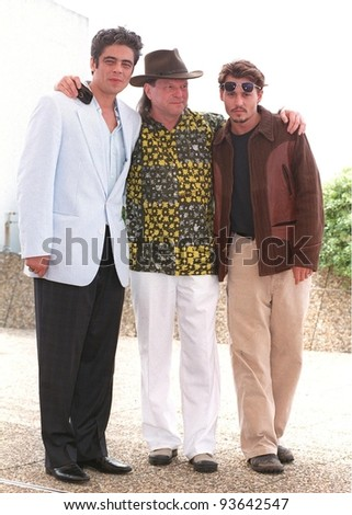 """15MAY98:  Actors JOHNNY DEPP (right) & BENICIO DEL TORO (right) with director TERRY GILLAM at the Cannes Film Festival to promote their new movie """"Fear and Loathing in Las Vegas."""" - stock photo"""