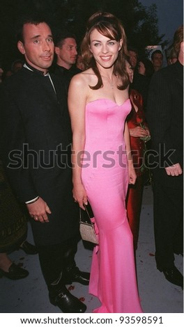 21MAY98:  Actress/model ELIZABETH HURLEY & escort  at AmFAR's Cinema Against AIDS gala at Moulin de Mougins, France.