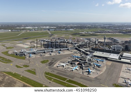 1 May 2016, Hoofddorp, Netherlands. Aerial view of Schiphol Amsterdam Airport on a clear blue day with a few cumulus clouds.