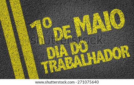 01 May Labour Day (in Portuguese) written on the road - stock photo