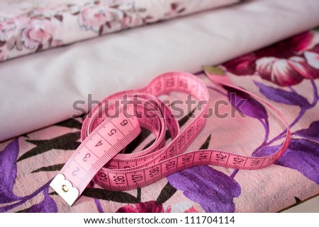 Measuring tape on fabric - stock photo