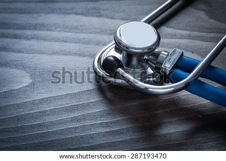 Medical diagnostic tool on wooden background medicine concept - stock photo