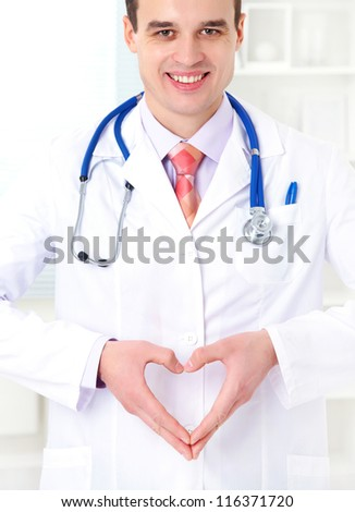 medical positive outlook doctor with gesture heart - stock photo