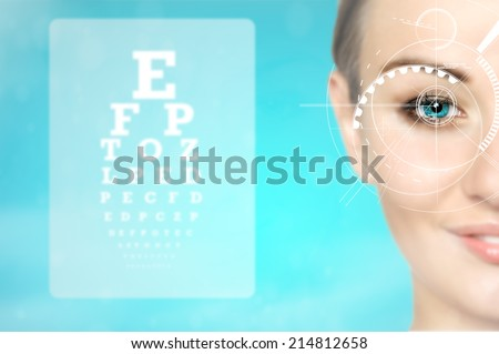 medicine and vision concept - woman and eye chart, future technology - stock photo