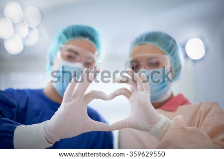 medicine, people, charity, health care and cardiology concept - doctors hands  making heart shape  - stock photo