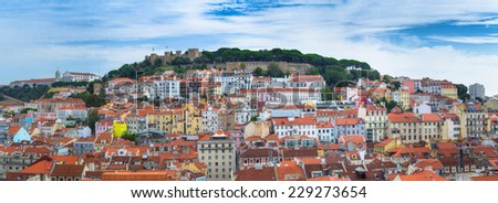 35 Megapixels Panorama view of old town Lisbon and Sao Jorge Castle, the capital and the largest city of Portugal. - stock photo