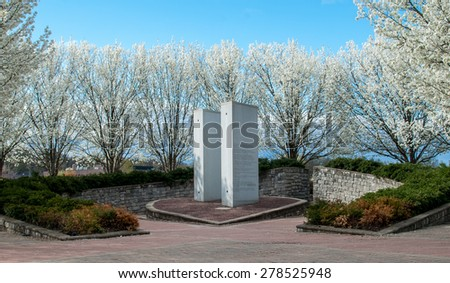 911 Memorial Overpeck Park, Leonia NJ. Springtime memorial for 9/11. Never forget, memorial. New York City, New Jersey monument. Park setting with cherry blossoms. Springtime in the outdoors.  - stock photo
