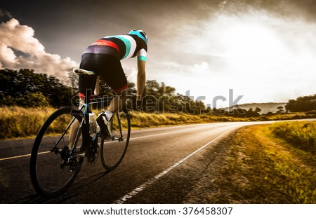 Men cycling road bike in the morning