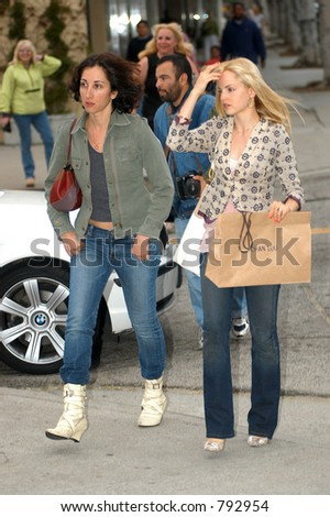 Mena Suvari shops with a friend in trendy Beverly Hills shops,  The stunning  Academy Award winner (American Beauty) shopped in the posh stores of Kitsons and Lisa Klein, Beverly Hills, Ca, 04/11/04 - stock photo