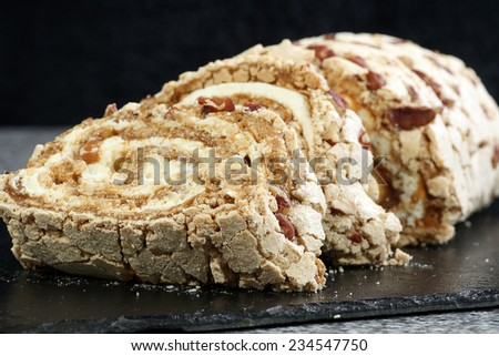 meringue roulade with fresh cream toffee and pecan nuts                              - stock photo