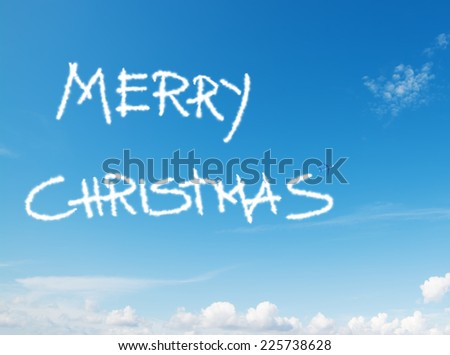 """merry christmas"" written in the sky with contrails left by airplane - stock photo"