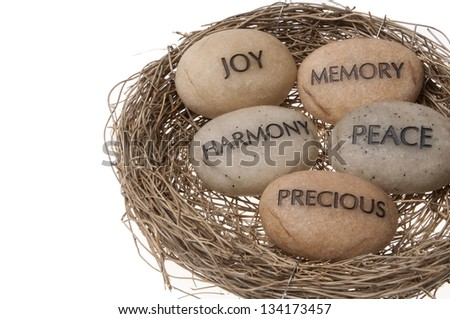 message stones in Easter basket isolated on white background