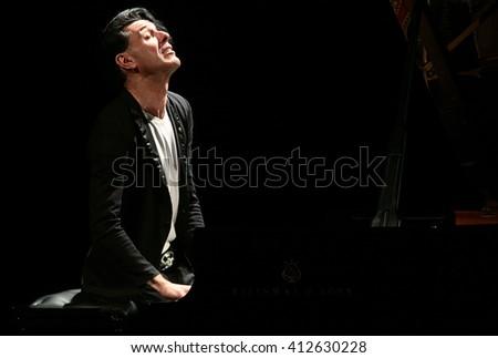 MESTRE, ITALY - APRIL 22: Pianist Ezio Bosso at the Toniolo theater on 22 April, 2016 in Venice, Italy  - stock photo